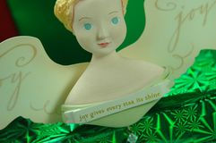 Joy to the World. An angel ornament on top of gift boxes stock photography