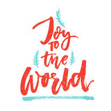 Joy to the world. Christmas greeting card with brush calligraphy. Handmade typography for gift tags. Vector red text Royalty Free Stock Photo