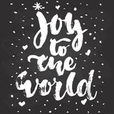 Joy to the world - hand drawn Christmas and New Year winter holidays lettering quote isolated on the black chalkboard Royalty Free Stock Photography
