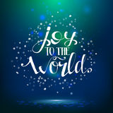 Joy to the world lettering at night background Stock Photos