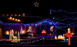 Joy to the World and Peace on Earth. A home on the tour of lights that is done in the classic Christmas motif royalty free stock photo