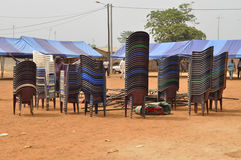 JOY AND TRUE FREEDOM. These chairs and tarpaulins for partisans is a meeting of preparation of President Laurent Gbagbo to celebrate the return of their mentor Royalty Free Stock Photo
