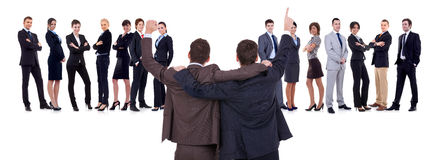 The joy of victory!. Back of two men leading a winning business team over white stock image