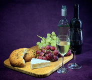 The joy of wine, bread and cheese Royalty Free Stock Images