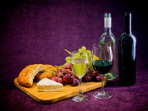 The joy of wine, bread and cheese Royalty Free Stock Image