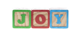 Joy wooden cubes Stock Image