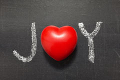 Joy word. Handwritten on chalkboard with heart symbol instead of O Royalty Free Stock Photos