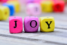 Joy word on table Royalty Free Stock Photo