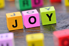 Joy word on table. Joy word on wooden table Royalty Free Stock Image