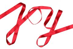 Joy word written in red ribbon Stock Photos