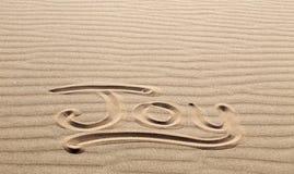 Joy Written im Sand am großem Sanddüne-Nationalpark und an PR Stockfoto
