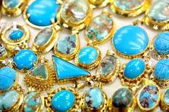 Joya de Golded con turquesa Fotografía de archivo libre de regalías