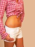 Joyería del botón de vientre. foto de archivo
