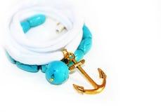 Joyería náutica - pulsera de la piedra preciosa de la turquesa con el ancla Imágenes de archivo libres de regalías