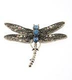 joyería pendiente de la libélula aislada en blanco Fotografía de archivo