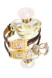 Joyería y perfume de oro fotografía de archivo
