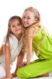Joyeuses filles sur le fond blanc Image libre de droits
