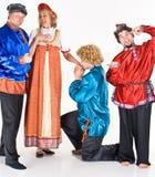 Joyeux acteurs dans le costume photo stock