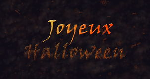 Joyeux Halloween text in French dissolving into dust to bottom Royalty Free Stock Images