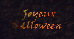 Joyeux Halloween text in French dissolving into dust to left Royalty Free Stock Photo