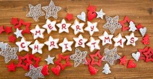 Joyeux Noël écrit sur des biscuits Photos libres de droits