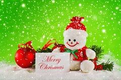 Joyeux Noël. Boules de Noël et bonhomme de neige de laine Photos stock