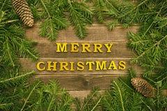 Joyeux Noël d'inscription sur un fond en bois La vue a fait o photos stock