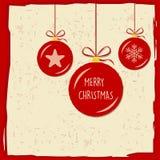 Joyeux Noël dans des boules de Noël dans le cadre rouge, carte de voeux Image libre de droits