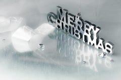 Joyeux Noël dans des lettres de chrome Image stock