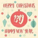 Joyeux Noël et bonne année 2019 sur la boule de Noël Carte de voeux avec la typographie de lettrage de main photo stock