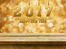 Joyeux Noël et bonne année 2017 sur la table en bois avec le gol Images libres de droits