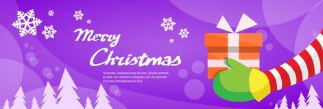 Joyeux Noël Santa Claus Hands Hold Gift Box Image libre de droits