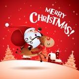 Joyeux Noël ! Santa Claus montant Rudolph Reindeer Photographie stock