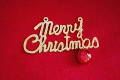 Joyeux Noël sur un fond rouge photographie stock