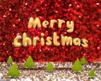 Joyeux Noël (texte de rendu 3D) flottant au-dessus du christma vert Photos libres de droits