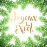 Joyeux Noel French Merry Christmas holiday golden hand drawn calligraphy text greeting and fir or pine branch wreath decoration fo. R card design template Stock Images