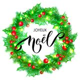 Joyeux Noel French Merry Christmas holiday hand drawn calligraphy text greeting and holly wreath decoration for card design templa. Te. Vector Christmas tree Stock Image