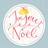 Joyeux Noel - french phrase means Merry Christmas. Modern calligraphy with swirls at round paper frame on pastel blue background. Vintage style vector Stock Photo