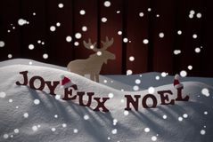 Joyeux Noel Means Merry Christmas With Moose Royalty Free Stock Photo