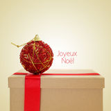 Joyeux noel, merry christmas in french, with a retro effect Royalty Free Stock Images