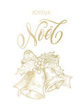 Joyeux Noel Merry Christmas gold bell ornament French greeting Royalty Free Stock Image