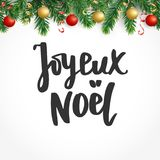 Joyeux noel text. Holiday greetings french quote. Fir tree branches and baubles. Great for Christmas cards, gift tags. Joyeux noel text, hand drawn lettering Stock Photography