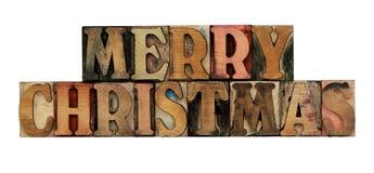 Joyeux Noël dans le type en bois d'impression typographique Photographie stock