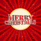 Joyeux Noël en cercle au-dessus de rétros rayons rouges Photographie stock libre de droits