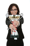 Joyfu female entrepreneur holding a trophy. Portrait of a joyful young female entrepreneur holding a trophy against white background Stock Photo
