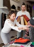 Joyful adult couple choosing clothes Royalty Free Stock Photos