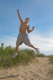 Joyful African American Male Jumping Outdoor Royalty Free Stock Photography
