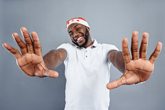 Joyful african Santa Claus gesturing positively Stock Image