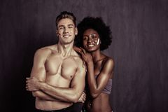 Joyful afro American woman standing with her boyfriend stock images