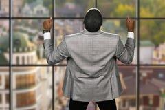 Joyful afro businessman wearing jacket. Stock Photography